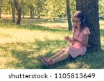cute girl listening to music... | Shutterstock . vector #1105813649