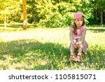 dreamy girl child sitting on... | Shutterstock . vector #1105815071
