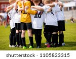 kids sports team with coach.... | Shutterstock . vector #1105823315