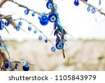 evil eye amulets hanging on a... | Shutterstock . vector #1105843979