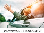 happy boy looks out from auto... | Shutterstock . vector #1105846319