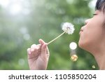asia child girl blowing... | Shutterstock . vector #1105850204