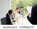 asian woman is raising her...   Shutterstock . vector #1105866737