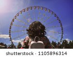girl looks at the  ferris wheel | Shutterstock . vector #1105896314