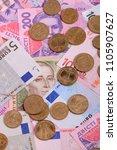 dollars euro hryvnia banknotes... | Shutterstock . vector #1105907627