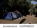 refugees and migrants rest in... | Shutterstock . vector #1105908425