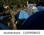 refugees and migrants rest in... | Shutterstock . vector #1105908431
