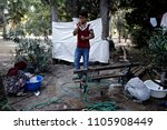 refugees and migrants rest in... | Shutterstock . vector #1105908449