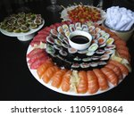 sushi  canap s and dishes for... | Shutterstock . vector #1105910864
