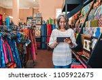 mature fabric shop owner using...   Shutterstock . vector #1105922675