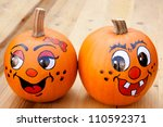 Painted Pumpkins On A Wooden...