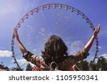 girl looks at the  ferris wheel | Shutterstock . vector #1105950341