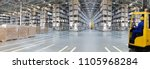 Huge distribution warehouse with high shelves and loaders. Bottom view. - stock photo