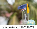 Small photo of Learning study international abroad in America concept: Graduate cap on blur of USA Statue of Liberty crystal souvenir with earth world globe model. Idea of Work and Travel studies program