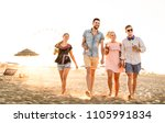 group of happy friends having... | Shutterstock . vector #1105991834