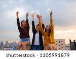 asian group of friends lighting ... | Shutterstock . vector #1105991879