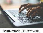 businesswoman using laptop ... | Shutterstock . vector #1105997381