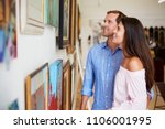 couple looking at paintings in... | Shutterstock . vector #1106001995
