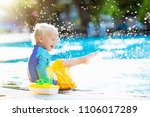 baby with toy boat in swimming... | Shutterstock . vector #1106017289