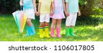 kids in rain boots. group of... | Shutterstock . vector #1106017805