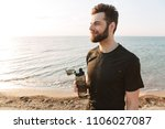 happy young sportsman holding... | Shutterstock . vector #1106027087