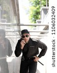 male security guard using... | Shutterstock . vector #1106032409