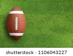 american football ball on green ... | Shutterstock . vector #1106043227