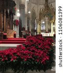 Small photo of New York, NY, USA January 3, 2018 The alter of St. Patrick's Cathedral in New York City is decorated with many poinsettias for the Christmas holiday.