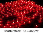 Many Red Votive Candles Light...