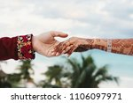 groom holds tender hand of... | Shutterstock . vector #1106097971