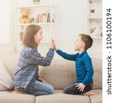 brother and sister playing...   Shutterstock . vector #1106100194