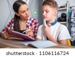 mother helping her son with... | Shutterstock . vector #1106116724