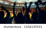 group of cheering fans watch a... | Shutterstock . vector #1106135531