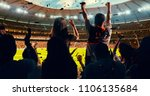 group of cheering fans watch a... | Shutterstock . vector #1106135684
