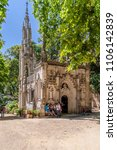 Small photo of Sintra, Portugal - July, 2015: Tourists visiting the Chapel in the Regaleira Palace and Gardens. A neo-manueline palace decorated with alchemy and freemasons symbols.