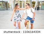 young lovely couple riding... | Shutterstock . vector #1106164334
