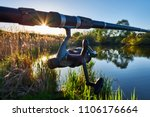 fishing reel on the rod.... | Shutterstock . vector #1106176664