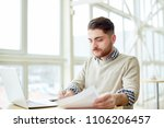 young man working with papers... | Shutterstock . vector #1106206457