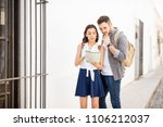 fashionably dressed couple of... | Shutterstock . vector #1106212037