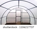 greenhouse inside empty steel... | Shutterstock . vector #1106217737