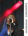black girl and backing singer... | Shutterstock . vector #1106246591