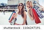 women in shopping. two happy... | Shutterstock . vector #1106247191