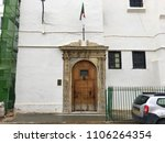 Small photo of Dar Aziza, Algiers, Algeria - March 30, 2018: Entrance door of Dar Aziza with Algerian flag.