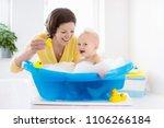 happy baby taking a bath... | Shutterstock . vector #1106266184