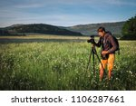 photographer takes a pictures...   Shutterstock . vector #1106287661