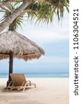 sun loungers with umbrella on a ... | Shutterstock . vector #1106304521