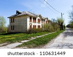 Abandoned house during day with street - stock photo