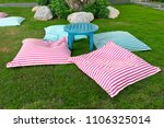 seat cushion with table at lawn ... | Shutterstock . vector #1106325014