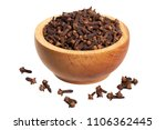 cloves in wooden bowl isolated... | Shutterstock . vector #1106362445