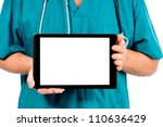 doctor's hands holding the tablet horizontally - stock photo